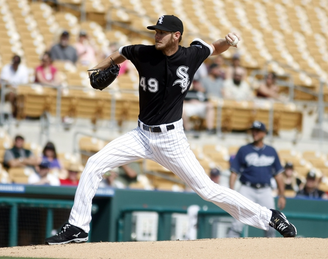 Mar 5, 2014; Phoenix, AZ, USA; Chicago White Sox starting pitcher Chris Sale (49) throws during the second inning against the San Diego Padres at Camelback Ranch. Mandatory Credit: Rick Scuteri-USA TODAY Sports