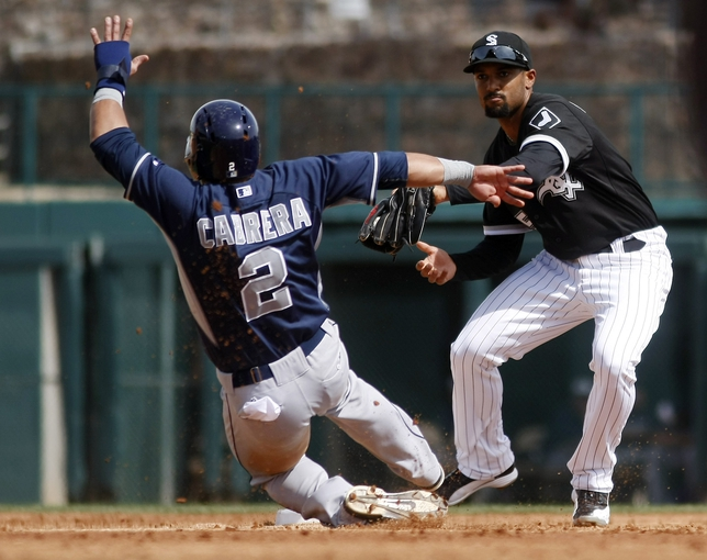 Mar 5, 2014; Phoenix, AZ, USA; Chicago White Sox shortstop Marcus Semien (5) forces out San Diego Padres shortstop Everth Cabrera (2) during the second inning at Camelback Ranch. Mandatory Credit: Rick Scuteri-USA TODAY Sports