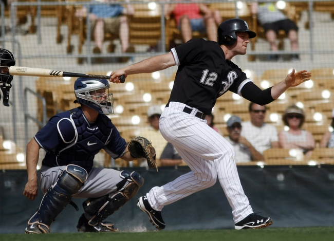 Mar 5, 2014; Phoenix, AZ, USA; Chicago White Sox third baseman Conor Gillaspie (12) singles during the first inning against the San Diego Padres at Camelback Ranch. Mandatory Credit: Rick Scuteri-USA TODAY Sports