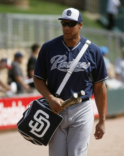 Mar 5, 2014; Phoenix, AZ, USA; San Diego Padres right fielder Kyle Blanks (88) walks to the dugout before a game against the Chicago White Sox at Camelback Ranch. Mandatory Credit: Rick Scuteri-USA TODAY Sports