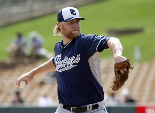 Mar 5, 2014; Phoenix, AZ, USA; San Diego Padres starting pitcher Andrew Cashner (34) throws during the first inning against the San Diego Padres at Camelback Ranch. Mandatory Credit: Rick Scuteri-USA TODAY Sports