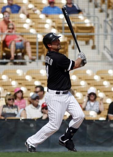 Mar 5, 2014; Phoenix, AZ, USA; Chicago White Sox first baseman Paul Konerko (14) singles during the fifth inning against the San Diego Padres at Camelback Ranch. Mandatory Credit: Rick Scuteri-USA TODAY Sports