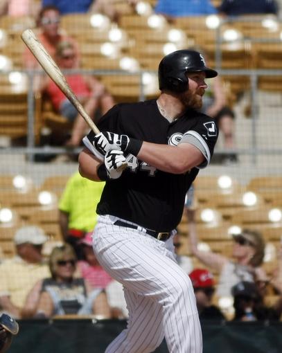 Mar 5, 2014; Phoenix, AZ, USA; Chicago White Sox designated hitter Adam Dunn (44) singles during the second inning at Camelback Ranch. Mandatory Credit: Rick Scuteri-USA TODAY Sports