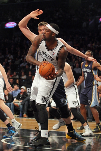 Mar 5, 2014; Brooklyn, NY, USA; Brooklyn Nets center Andray Blatche (0) is fouled by Memphis Grizzlies center Marc Gasol (33) during the first quarter of a game at Barclays Center. Mandatory Credit: Brad Penner-USA TODAY Sports