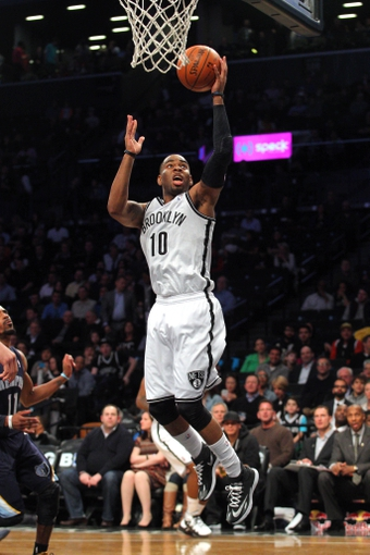 Mar 5, 2014; Brooklyn, NY, USA; Brooklyn Nets shooting guard Marcus Thornton (10) drives to the basket during the third quarter of a game against the Memphis Grizzlies at Barclays Center. The Nets defeated the Grizzlies 103-94. Mandatory Credit: Brad Penner-USA TODAY Sports