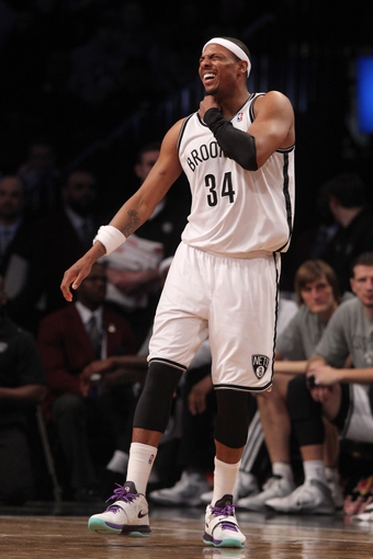 Mar 5, 2014; Brooklyn, NY, USA; Brooklyn Nets small forward Paul Pierce (34) reacts after an apparent injury during the third quarter of a game at Barclays Center. Pierce came out of the game but would return later in the third quarter. The Nets defeated the Grizzlies 103-94. Mandatory Credit: Brad Penner-USA TODAY Sports