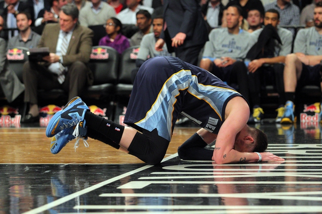 Mar 5, 2014; Brooklyn, NY, USA; Memphis Grizzlies small forward Mike Miller (13) reacts after an apparent injury during the fourth quarter of a game against the Brooklyn Nets at Barclays Center. The Nets defeated the Grizzlies 103-94. Mandatory Credit: Brad Penner-USA TODAY Sports