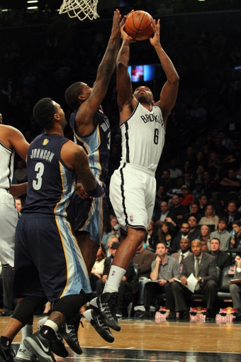 Mar 5, 2014; Brooklyn, NY, USA; Brooklyn Nets small forward Alan Anderson (6) is blocked by Memphis Grizzlies power forward Ed Davis (32) during the fourth quarter of a game at Barclays Center. The Nets defeated the Grizzlies 103-94. Mandatory Credit: Brad Penner-USA TODAY Sports