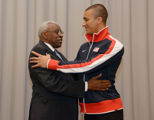 Mar 6, 2014; Sopot, Poland; Ashton Eaton (USA), right, and IAAF president Lamine Diack at press conference at the Sheraton Sopot Hotel, Conference Center & Spa in advance of the IAAF World Indoor Championships in Athletics. Mandatory Credit: Kirby Lee-USA TODAY Sports