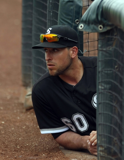 Mar 6, 2014; Surprise, AZ, USA; Chicago White Sox third baseman Alex Liddi (60) watches from the dugout stairs in the fourth inning against the Kansas City Royals at Surprise Stadium. Mandatory Credit: Rick Scuteri-USA TODAY Sports