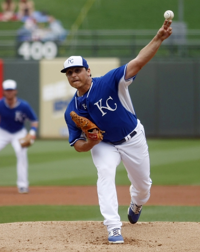 Mar 6, 2014; Surprise, AZ, USA; Kansas City Royals starting pitcher Jason Vargas (51) throws in the first inning against the Chicago White Sox at Surprise Stadium. Mandatory Credit: Rick Scuteri-USA TODAY Sports
