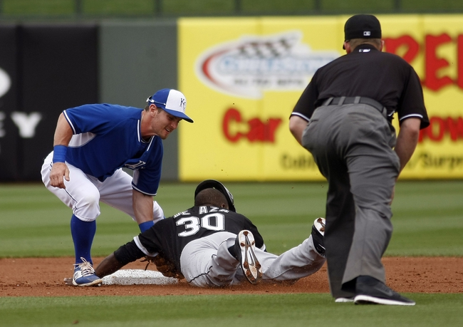 Mar 6, 2014; Surprise, AZ, USA; Kansas City Royals second baseman Johnny Giavotella (9) tags out Chicago White Sox starting pitcher Erik Johnson (45) trying to steal second base in the first inning at Surprise Stadium. Mandatory Credit: Rick Scuteri-USA TODAY Sports