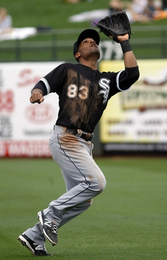 Mar 6, 2014; Surprise, AZ, USA; Chicago White Sox second baseman Micah Johnson (83) looks to make the catch against the Kansas City Royals in the third inning at Surprise Stadium. Mandatory Credit: Rick Scuteri-USA TODAY Sports