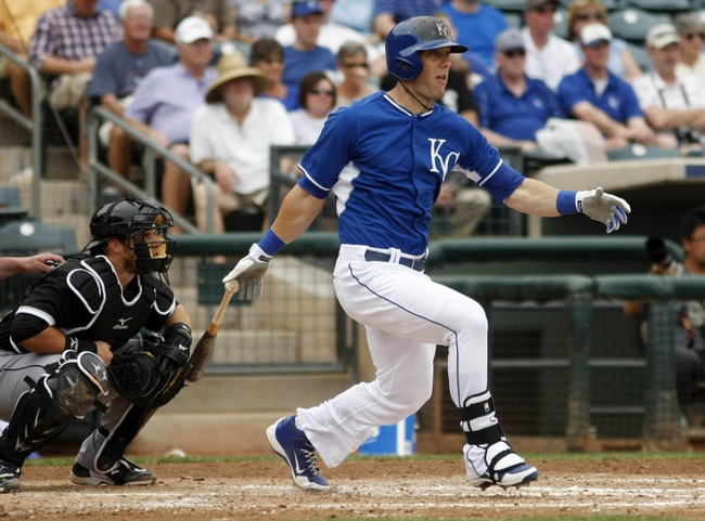 Mar 6, 2014; Surprise, AZ, USA; Kansas City Royals left fielder Alex Gordon (4) hits an RBI singles in the third inning against the Chicago White Sox at Surprise Stadium. Mandatory Credit: Rick Scuteri-USA TODAY Sports