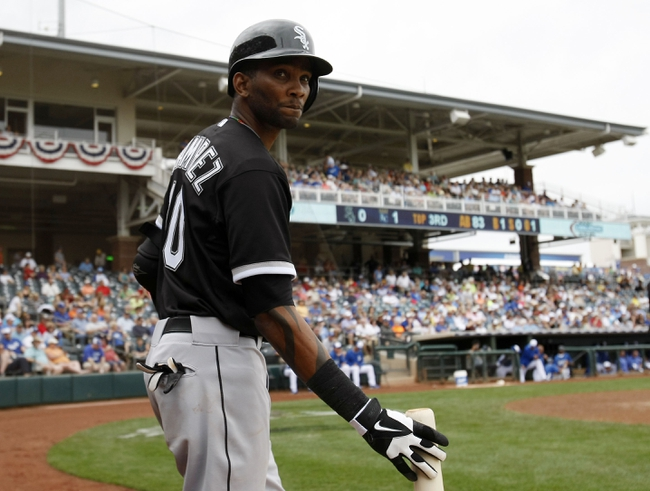 Mar 6, 2014; Surprise, AZ, USA; Chicago White Sox shortstop Alexei Ramirez (10) waits on deck against the Kansas City Royals in the third inning at Surprise Stadium. Mandatory Credit: Rick Scuteri-USA TODAY Sports
