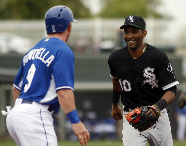 Mar 6, 2014; Surprise, AZ, USA; Chicago White Sox shortstop Alexei Ramirez (10) tries to tag out Kansas City Royals second baseman Johnny Giavotella (9) in the fourth inning at Surprise Stadium. Mandatory Credit: Rick Scuteri-USA TODAY Sports
