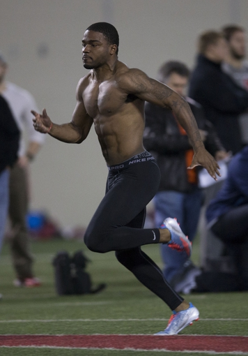 Mar 7, 2014; Columbus, OH, USA; Ohio State Buckeyes safety CJ Barnett works out in front of NFL scouts on pro day  at The Woody Hayes Athletic Center. Mandatory Credit: Greg Bartram-USA TODAY Sports