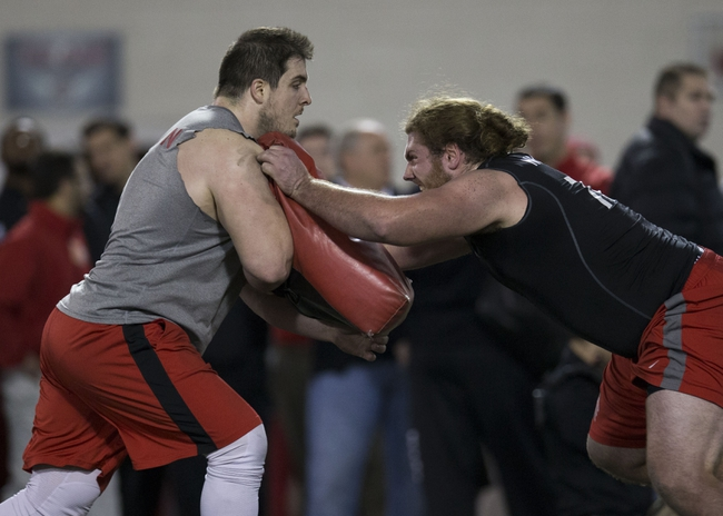 Mar 7, 2014; Columbus, OH, USA; Ohio State Buckeyes offensive linemen Corey Linsley (l) and Andrew Norwell work out in front of NFL scouts on pro day  at The Woody Hayes Athletic Center. Mandatory Credit: Greg Bartram-USA TODAY Sports