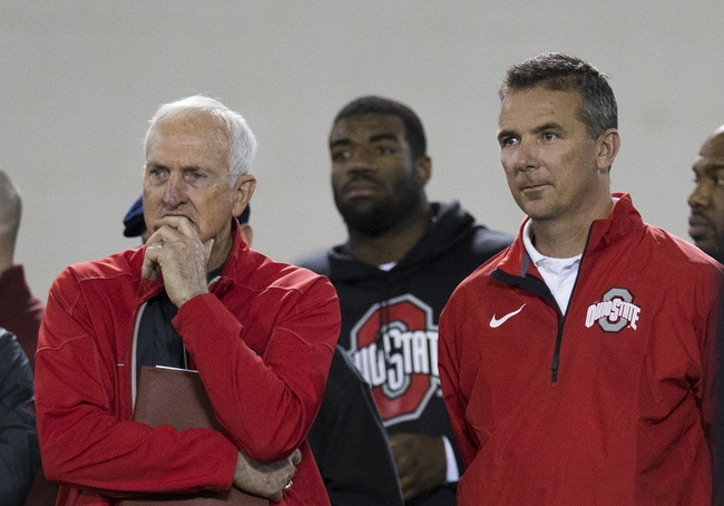 Mar 7, 2014; Columbus, OH, USA; Ohio State Buckeyes head coach Urban Meyer (r) and former head coach and current Cincinnati Bengals scouting consultant John Cooper watch as players work out in front of NFL scouts on pro day  at The Woody Hayes Athletic Center. Mandatory Credit: Greg Bartram-USA TODAY Sports