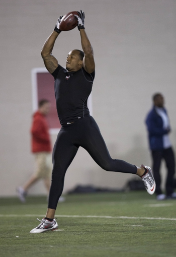 Mar 7, 2014; Columbus, OH, USA; Ohio State Buckeyes linebacker Ettienne Sabino works out in front of NFL scouts on pro day  at The Woody Hayes Athletic Center. Mandatory Credit: Greg Bartram-USA TODAY Sports