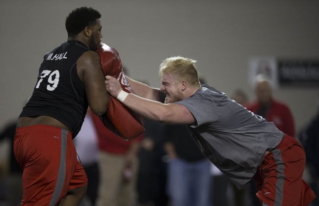 Mar 7, 2014; Columbus, OH, USA; Ohio State Buckeyes offensive linemen Marcus Hall and Jack Mewhort work out in front of NFL scouts on pro day  at The Woody Hayes Athletic Center. Mandatory Credit: Greg Bartram-USA TODAY Sports