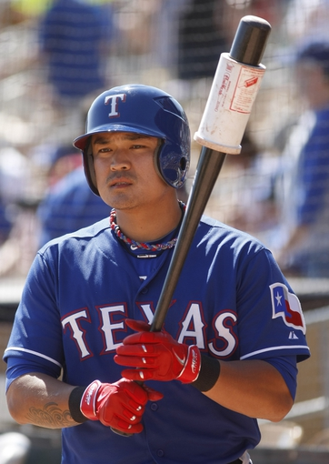 Mar 7, 2014; Phoenix, AZ, USA; Texas Rangers left fielder Shin-Soo Choo (17) waits to hit before a game against the Los Angeles Dodgers at Camelback Ranch. Mandatory Credit: Rick Scuteri-USA TODAY Sports