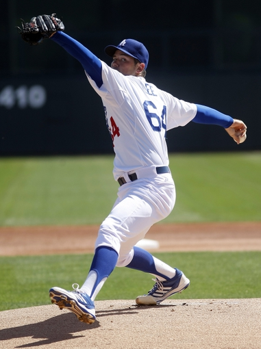 Mar 7, 2014; Phoenix, AZ, USA; Los Angeles Dodgers relief pitcher Zach Lee (64) throws in the first inning against the Texas Rangers at Camelback Ranch. Mandatory Credit: Rick Scuteri-USA TODAY Sports