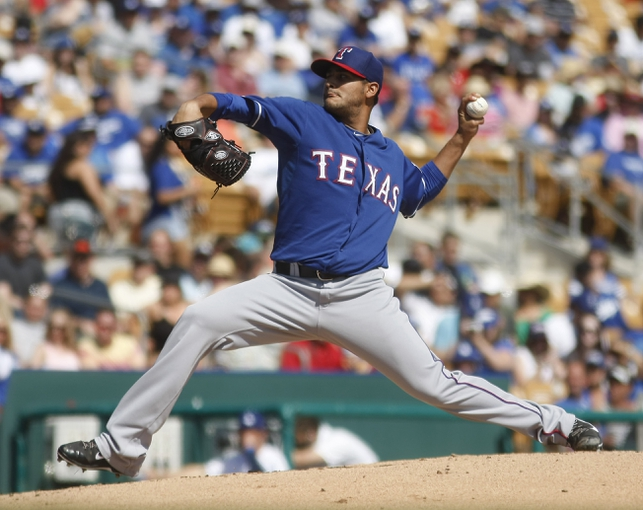 Mar 7, 2014; Phoenix, AZ, USA; Texas Rangers starting pitcher Martin Perez (33) throws in the first inning against the Los Angeles Dodgers at Camelback Ranch. Mandatory Credit: Rick Scuteri-USA TODAY Sports