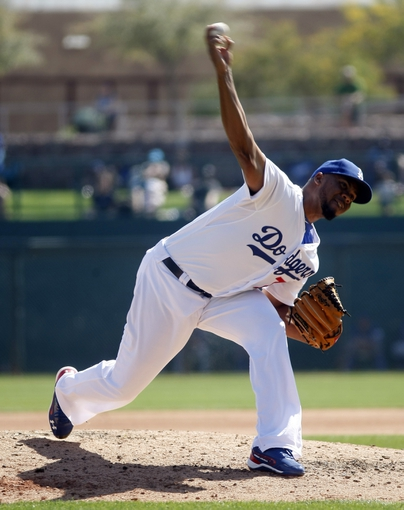 Mar 7, 2014; Phoenix, AZ, USA; Los Angeles Dodgers relief pitcher Kenley Jansen (74) throws in the fourth inning against the Texas Rangers at Camelback Ranch. Mandatory Credit: Rick Scuteri-USA TODAY Sports