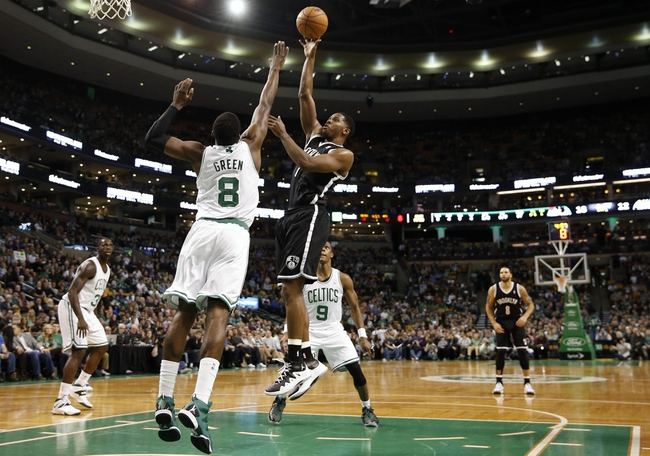 Mar 7, 2014; Boston, MA, USA; Brooklyn Nets shooting guard Joe Johnson (7) shoots from the lane over Boston Celtics small forward Jeff Green (8) during the first quarter at TD Garden. Mandatory Credit: Winslow Townson-USA TODAY Sports