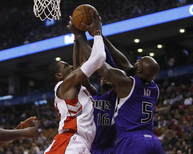 Mar 7, 2014; Toronto, Ontario, CAN; Toronto Raptors forward Patrick Patterson (54)  battles with Sacramento Kings guard Ben McLemore (16) and forward Quincy Acy (5) for the ball during the first half at Air Canada Centre. Mandatory Credit: John E. Sokolowski-USA TODAY Sports