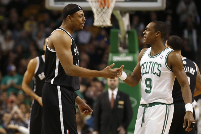 Mar 7, 2014; Boston, MA, USA; Boston Celtics point guard Rajon Rondo (9) greets former teammate Brooklyn Nets small forward Paul Pierce (34) before their game at TD Garden. Mandatory Credit: Winslow Townson-USA TODAY Sports
