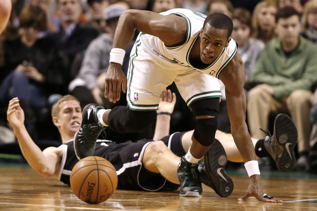 Mar 7, 2014; Boston, MA, USA; Boston Celtics point guard Rajon Rondo (9) eyes a loose ball in front of fallen Brooklyn Nets power forward Mason Plumlee (1) during the second quarter at TD Garden. Mandatory Credit: Winslow Townson-USA TODAY Sports