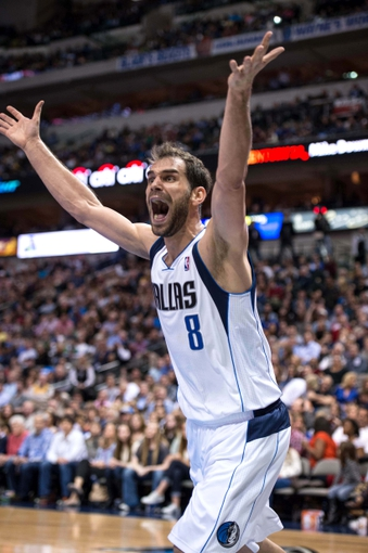 Mar 7, 2014; Dallas, TX, USA; Dallas Mavericks point guard Jose Calderon (8) argues a call with the referees during the first half against the Portland Trail Blazers at the American Airlines Center. Mandatory Credit: Jerome Miron-USA TODAY Sports