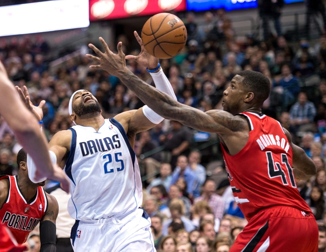 Mar 7, 2014; Dallas, TX, USA; Portland Trail Blazers power forward Thomas Robinson (41) knocks the ball away from Dallas Mavericks shooting guard Vince Carter (25) during the first half at the American Airlines Center. Mandatory Credit: Jerome Miron-USA TODAY Sports