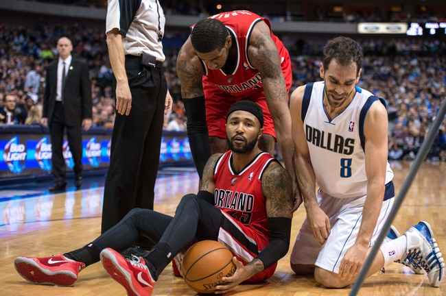 Mar 7, 2014; Dallas, TX, USA; Portland Trail Blazers point guard Mo Williams (25) and Dallas Mavericks point guard Jose Calderon (8) are separated after fighting for the ball during the first half at the American Airlines Center. Mandatory Credit: Jerome Miron-USA TODAY Sports