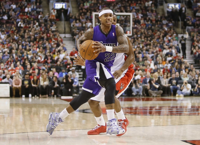 Mar 7, 2014; Toronto, Ontario, CAN; Sacramento Kings guard Isaiah Thomas (22) carries the ball past Toronto Raptors guard Kyle Lowry (7) during the second half at the Air Canada Centre. Toronto defeated Sacramento 99-87. Mandatory Credit: John E. Sokolowski-USA TODAY Sports