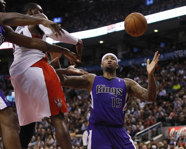 Mar 7, 2014; Toronto, Ontario, CAN; Sacramento Kings center DeMarcus Cousins (15) comes down with a rebound against Toronto Raptors forward Patrick Patterson (54) during the second half at the Air Canada Centre. Toronto defeated Sacramento 99-87. Mandatory Credit: John E. Sokolowski-USA TODAY Sports