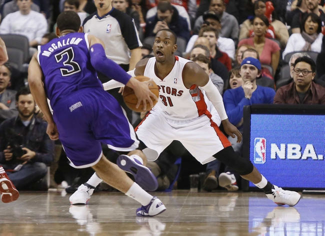 Mar 7, 2014; Toronto, Ontario, CAN; Toronto Raptors guard Terrence Ross (31) defends against Sacramento Kings guard Ray McCallum (3) during the second half at the Air Canada Centre. Toronto defeated Sacramento 99-87. Mandatory Credit: John E. Sokolowski-USA TODAY Sports