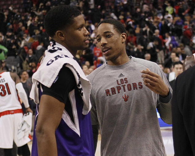 Mar 7, 2014; Toronto, Ontario, CAN; Sacramento Kings forward Rudy Gay (left) and Toronto Raptors guard DeMar DeRozan (right) talk after the game at the Air Canada Centre. Toronto defeated Sacramento 99-87. Mandatory Credit: John E. Sokolowski-USA TODAY Sports