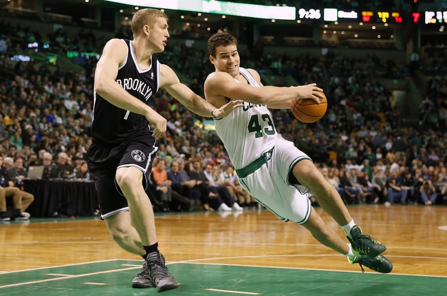 Mar 7, 2014; Boston, MA, USA; Boston Celtics center Kris Humphries (43) tries to drive around Brooklyn Nets power forward Mason Plumlee (1) during the second half of Boston's 91-84 win at TD Garden. Mandatory Credit: Winslow Townson-USA TODAY Sports
