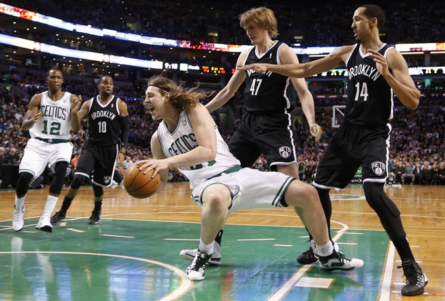 Mar 7, 2014; Boston, MA, USA; Boston Celtics center Kelly Olynyk (41) falls while trying to get past Brooklyn Nets small forward Andrei Kirilenko (47) and point guard Shaun Livingston (14) during the second half of Boston's 91-84 win at TD Garden. Mandatory Credit: Winslow Townson-USA TODAY Sports