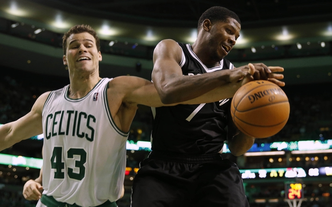 Mar 7, 2014; Boston, MA, USA; Boston Celtics center Kris Humphries (43) knocks the ball away from Brooklyn Nets shooting guard Joe Johnson (7) during the second half of Boston's 91-84 win at TD Garden. Mandatory Credit: Winslow Townson-USA TODAY Sports