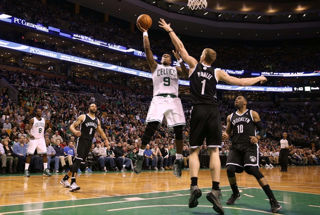 Mar 7, 2014; Boston, MA, USA; Boston Celtics point guard Rajon Rondo (9) goes for a shot in the lane over Brooklyn Nets power forward Mason Plumlee (1) during the second half of Boston's 91-84 win at TD Garden. Mandatory Credit: Winslow Townson-USA TODAY Sports