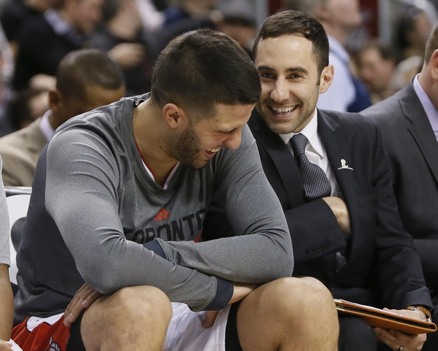 Mar 7, 2014; Toronto, Ontario, CAN; Toronto Raptors assistant coach Jesse Mermuys (right) and guard Greivis Vasquez (21) during a break in the action against the Sacramento Kings at the Air Canada Centre. Toronto defeated Sacramento 99-87. Mandatory Credit: John E. Sokolowski-USA TODAY Sports