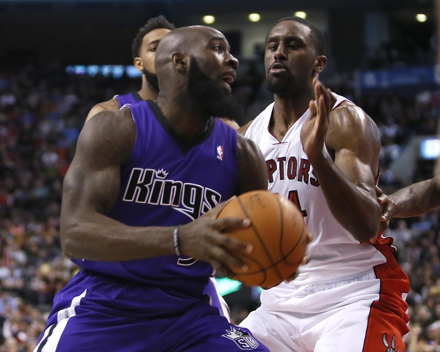 Mar 7, 2014; Toronto, Ontario, CAN; Toronto Raptors forward Patrick Patterson (54) defends against Sacramento Kings forward Quincy Acy (5) during the second half at the Air Canada Centre. Toronto defeated Sacramento 99-87. Mandatory Credit: John E. Sokolowski-USA TODAY Sports