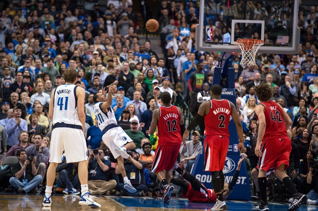 Mar 7, 2014; Dallas, TX, USA; Dallas Mavericks point guard Devin Harris (20) makes a basket and is fouled to give the Mavericks the lead over the Portland Trail Blazers at the American Airlines Center. The Mavericks defeated the Trail Blazers 103-98. Mandatory Credit: Jerome Miron-USA TODAY Sports