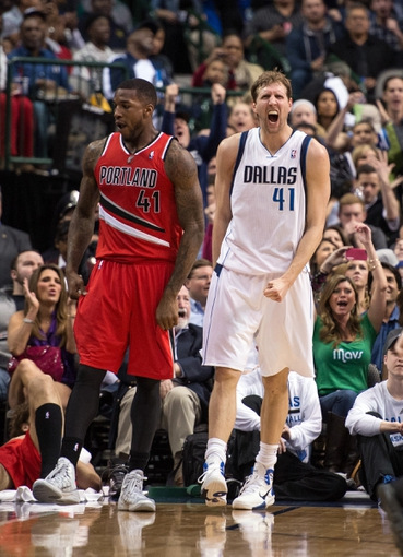 Mar 7, 2014; Dallas, TX, USA; Dallas Mavericks power forward Dirk Nowitzki (41) reacts to being fouled during the second half against the Portland Trail Blazers at the American Airlines Center. The Mavericks defeated the Trail Blazers 103-98. Mandatory Credit: Jerome Miron-USA TODAY Sports
