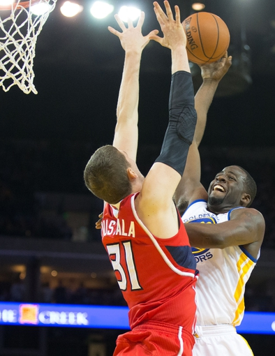 Mar 7, 2014; Oakland, CA, USA; Golden State Warriors small forward Draymond Green (23) shoots the ball against Atlanta Hawks center Mike Muscala (31) during the fourth quarter at Oracle Arena. The Golden State Warriors defeated the Atlanta Hawks 111-97. Mandatory Credit: Kelley L Cox-USA TODAY Sports