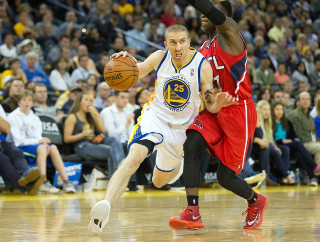 Mar 7, 2014; Oakland, CA, USA; Golden State Warriors point guard Steve Blake (25) drives in against Atlanta Hawks point guard Dennis Schroder (17) during the fourth quarter at Oracle Arena. The Golden State Warriors defeated the Atlanta Hawks 111-97. Mandatory Credit: Kelley L Cox-USA TODAY Sports